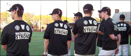 Watertown High School players line up in Watertown Strong T-shirts at Victory Field.